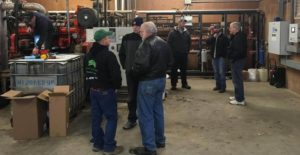 Farmers learning about the methane digester process